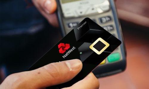 NatWest employee testing bank cards that lets customers use fingerprints for transactions